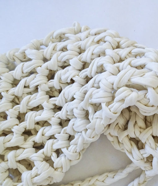 Close-up of the white knitted yoga matt bag